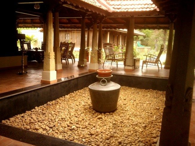 Classy n trendy central courtyard at some hotel in kerala for Classic house design in india