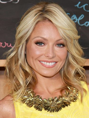 To get Kelly Ripa's hair style, blow dry #hair opposite the way it grows naturally, set in rollers and then separate #curls with a wide-toothed comb.