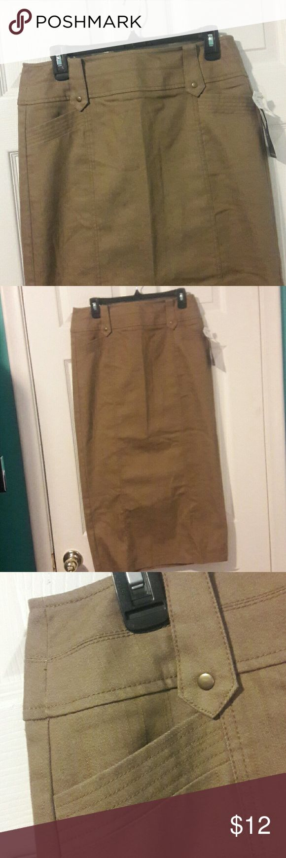 NEW NYCC PENCIL SKIRT New. Fabulous New York Clothing Company pencil skirt. 73% cotton 26% polyester 1% spandex. 35 in Long from waist to bottom. Almond color brown. Pockets in front. Slit in the back. New York Clothing Co Skirts Pencil