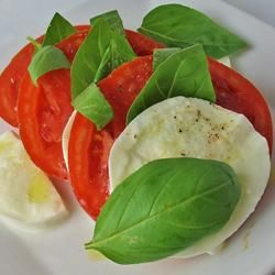 """Insalata Caprese II- Caprese Salad- Recipe author says """"Because this salad is so simple, fresh, top-quality tomatoes and mozzarella are important."""" I can't remember the last time I saw good ripe quality tomatoes to be honest. They all taste bland. Would love to find some heirloom tomatoes for this. Ingredients- ripe tomatoes, fresh mozzarella, fresh basil, olive oil Allrecipes.com"""