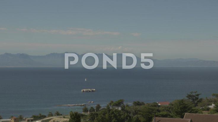 4k Beautiful Blue Water Ocean View Mountains In Background - Stock Footage   by RyanJonesFilms