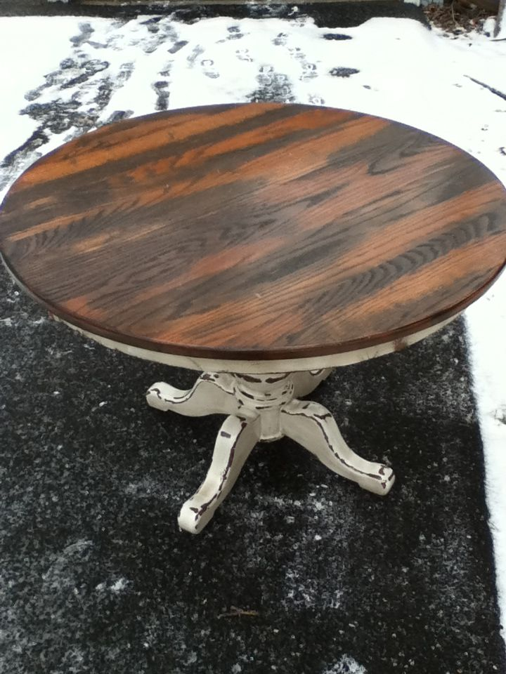 Round dining table stripped and refinished on top with heavily distressed painted bottom