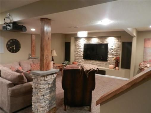 Basement feature wall with TV. Use brick veneer and frame the area.