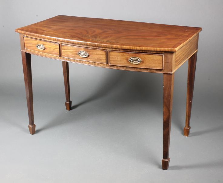 """Lot 1018, A 19th Century mahogany bow front side table with crossbanded top, fitted 3 short drawers, raised on square tapering supports, spade feet, 31""""h x 44""""w x 22""""d, est £250-300"""