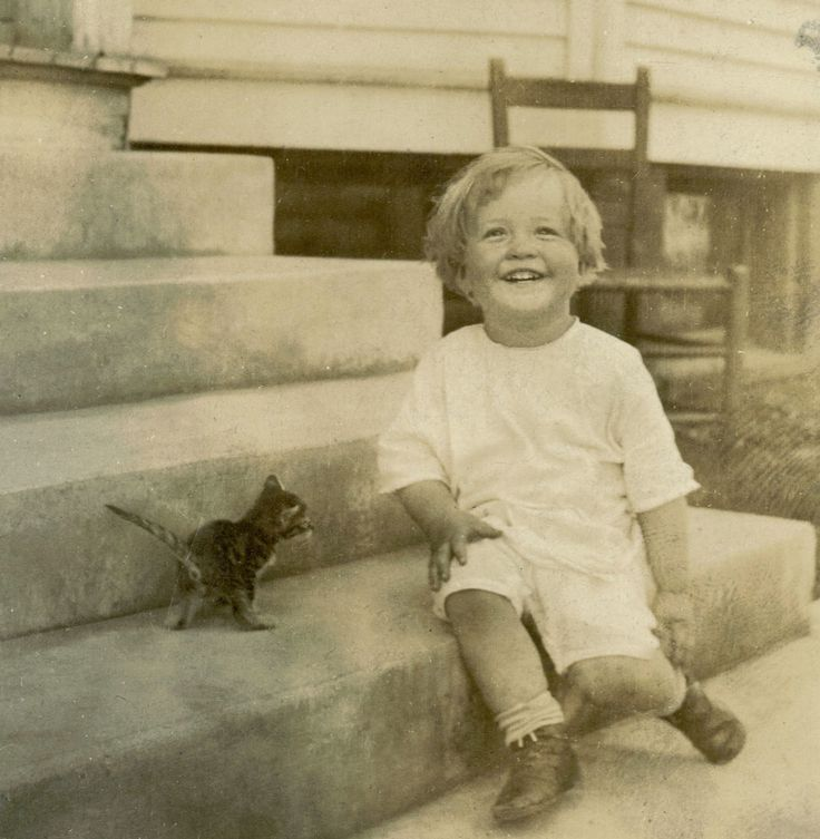 Toddler and kitten, location unknown, June 20, 1914