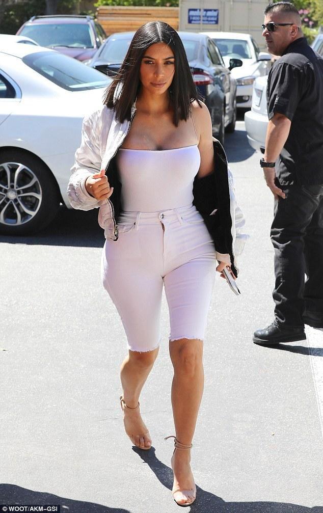 Kim Kardashian wearing Manolo Blahnik Estro Sandals, Good American Good Legs Jeans in White001 and Naked Wardrobe U Really Suit Me Bodysuit