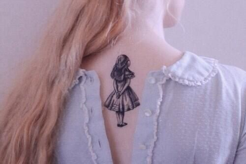 Tattoo - Alice in Wonderland. Love this! Maybe infront of a mirror with some fire?