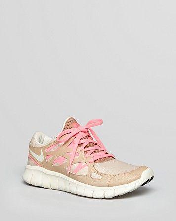 Gold and Pink Nike Free Runs
