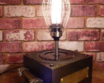 VINTAGE EDISON AND COLLECTIBLES LAMP - CANADIAN CAR AND BRILL COACH CUSTOM LAMP - VERY COOL VINTAGE COLLECTIBLES LAMP. EDISON BULB, AUTOMOTIVE PARTS, CANADIAN CAR - BRILL CAR PLAQUE AND PUMP FOR VINTAGE IRON. COOL!!!
