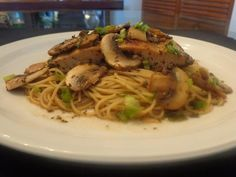 Mahi mahi and pasta with Asian flavored mushroom sauce. Cook mahi mahi in a skillet with olive oil, white wine, basil, mushrooms, butter and soy sauce. Coat the angel hair pasta with the mushroom sauce that cooked mahi mahi. Top with minced scallions.