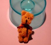 "1 1/4"" teddy bear.  Arms are jointed."