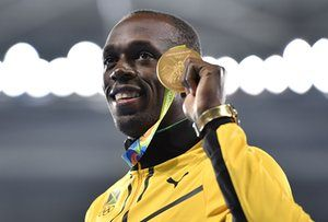 Jamaica's Usain Bolt shows off Olympic gold medal number eight.