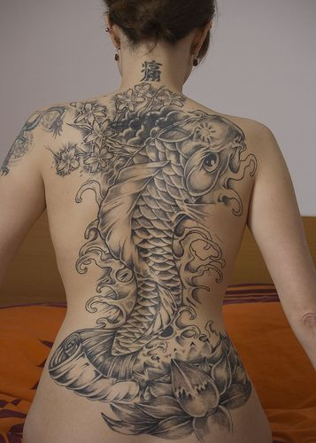 Google Image Result for http://www.bloggerswatch.com/wp-content/uploads/2009/04/tiger-and-koi-japanese-tattoos.jpg