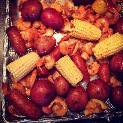 Low Country Boil   Print Ingredients 2 lb. red new potatoes 1 lb. Kielbasa (cut into quarters) 1 lb. Cajun Andouille sausage (cut into quarters) 6 ears corn (cut in half) 3 pounds fresh shrimp, unpeeled old bay seasoning cocktail sauce lemons Instructions Place potatoes in bottom of large pot and cover with water. …