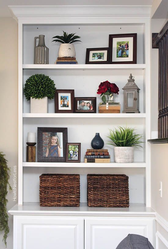 Styled family room bookshelves shelving room and living for Shelves for living room decorations