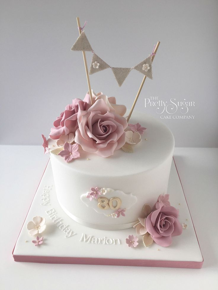 Vintage style 80th birthday cake with sugar roses and bunting topper