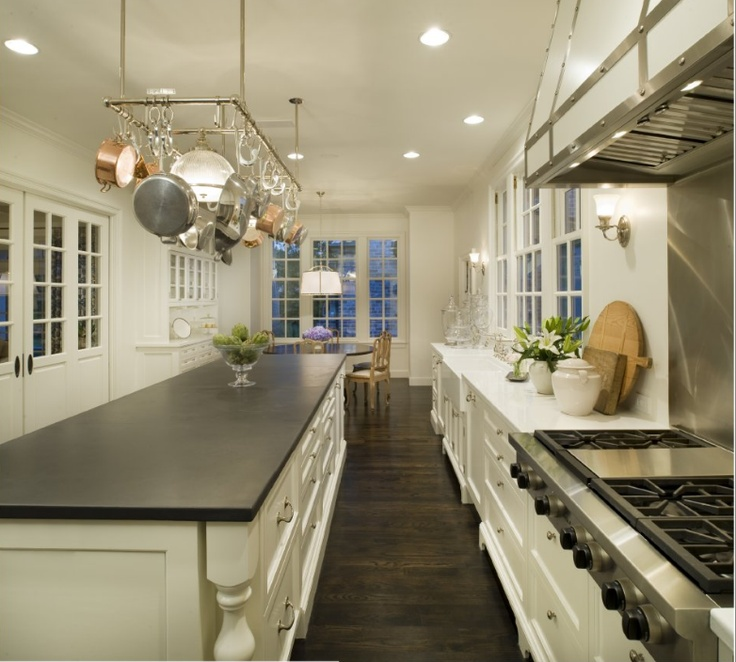 I have a soapstone work island and I absolutely love it, the patina is beautiful in comparison to shiny granite...
