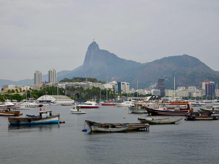 Fishermen's boats and Cristo Redentor in Rio