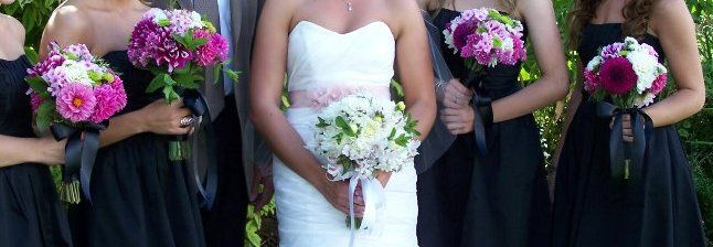 Bridal and bridesmaids bouquets with Dahlias, phlox, stattice, Peruvian lilies, and mint leaves tied with black satin ribbon and white satin ribbon for bride