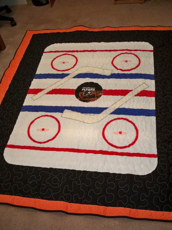 For a boys room, maybe a bit smaller as a wall hanging    Custom Made Team Hockey Quilt by LittlePatches on Etsy, $175.00