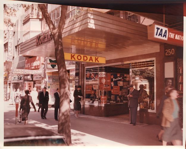 Footpath in front of Kodak shop. Kodak Australasia Pty Ltd, Shop Entrance, Kodak House, 252 Collins St, Mebourne, circa 1950s