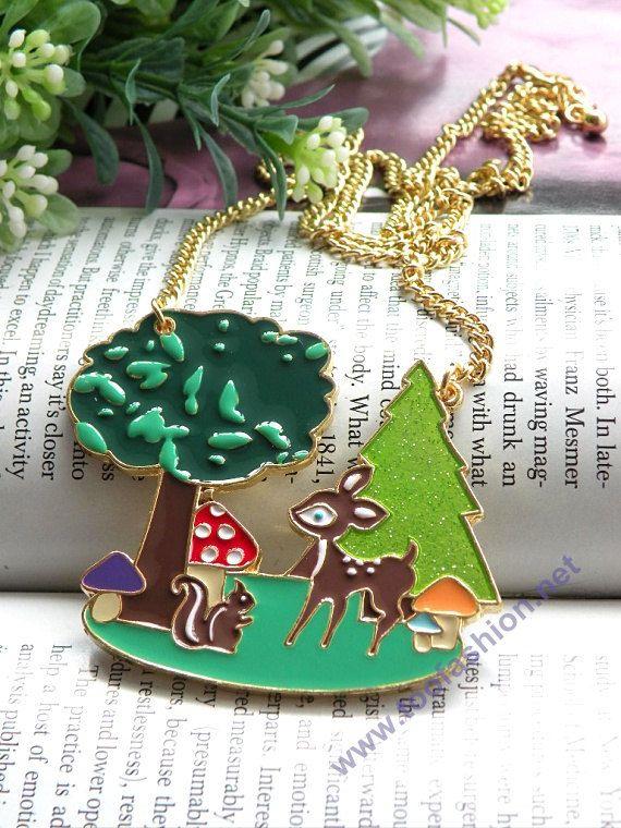 Pretty retro gold green tree Christmas tree with mushroom deer squirrel pendant necklace vintage style. $5.99, via Etsy.