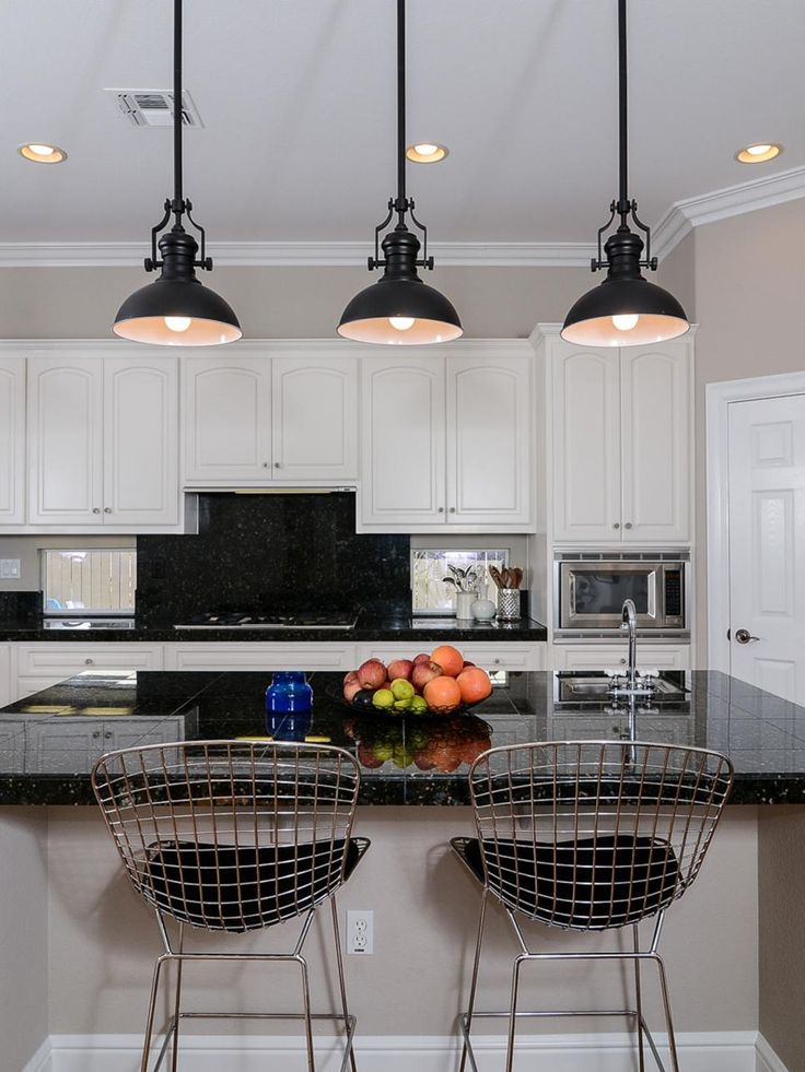 a pair of stylish mesh back barstools serve as seating at this eat in white kitchen islandkitchen blackwhite - Black Kitchen Lights