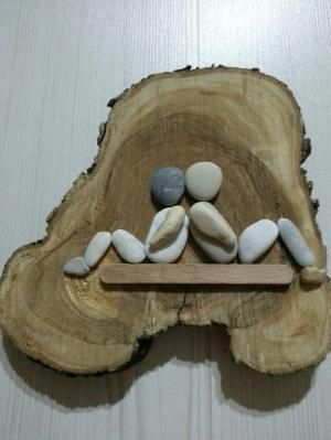 Pebble art on wood by edna