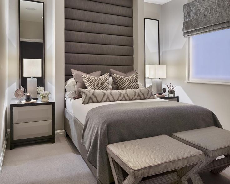 """The oversized headboard in this compact guest bedroom gives the room presence and I love the cute upholstered X stools #luxuryinteriors #interiors…"""