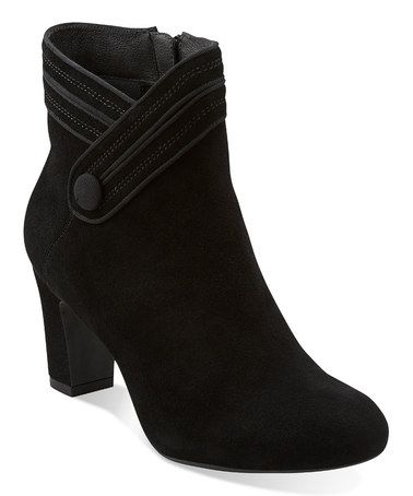 Not Leona, but these Clark's Tamryn black suede ankle boots look fabulous with almost all of my fab dress collection. Comfy too!