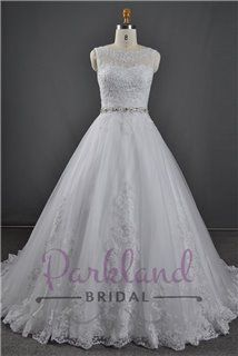 A beautiful lace and tulle gown, features a stunning sheer lace neckline and luxury beading at the waist.