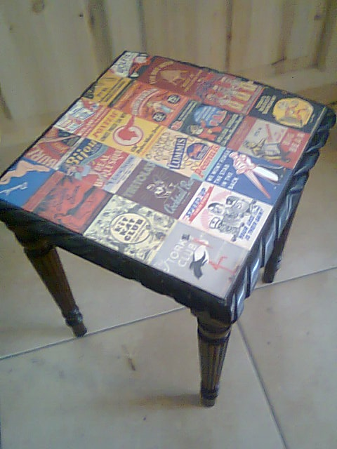 table decoupage with vintage matchbox art.