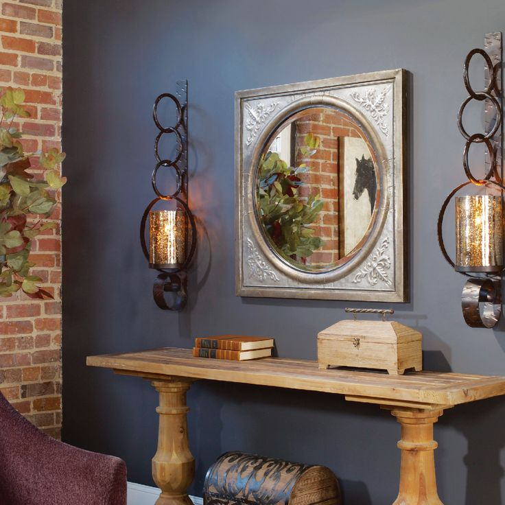 Careful Attention To Detail And Tasteful Home Accessories Such As Wall  Sconces And Mirrors Create A