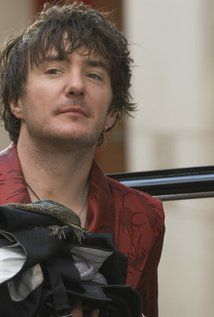 """Irish comedian Dylan Moran was born in Navan, County Meath in 1971. Leaving school without any qualifications at age 16, Moran quickly became attracted to stand-up comedy and debuted, in 1992, at a comedy club in Dublin, The Comedy Cellar. A year later, he won the Channel Four comedy newcomer's """"So You Think You're Funny"""" award at the Edinburgh ... later played the eccentric owner of 'Black Books'"""