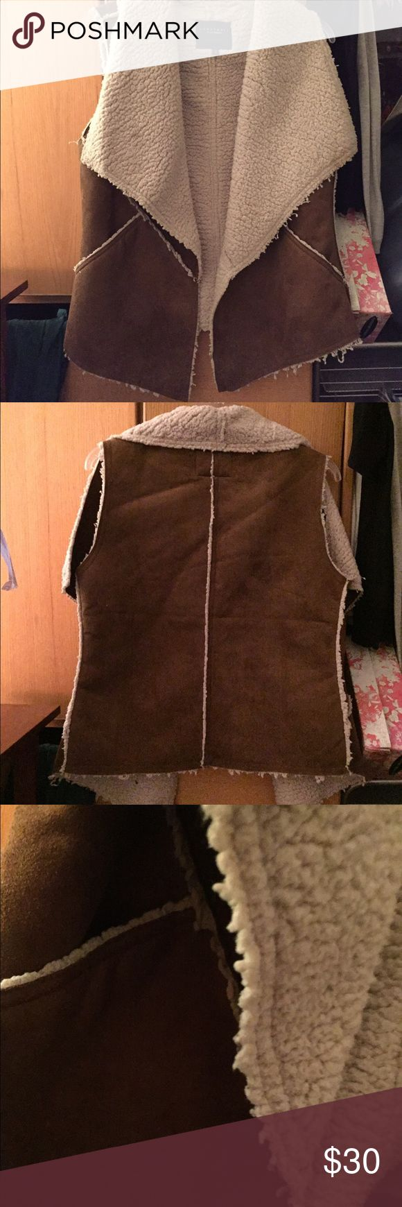 Brown suede shearling vest Tan/brown suede and shearling vest! In excellent condition. Sanctuary Jackets & Coats Vests