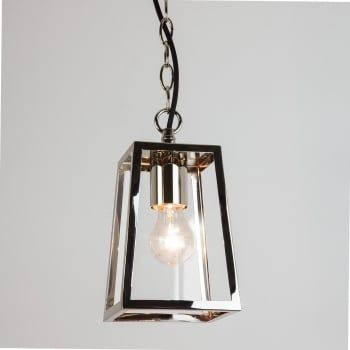An exterior box lantern design ceiling pendant in a  polished nickel finish with clear glass panels. The light is suspended on a chain which can be adjusted at the point of installation to suit most ceiling heights. It is double insulated for safe use without need of an earth wire and is IP23 rated for safe outdoor use. We love this for lighting in a porch, summerhouse or pergola.