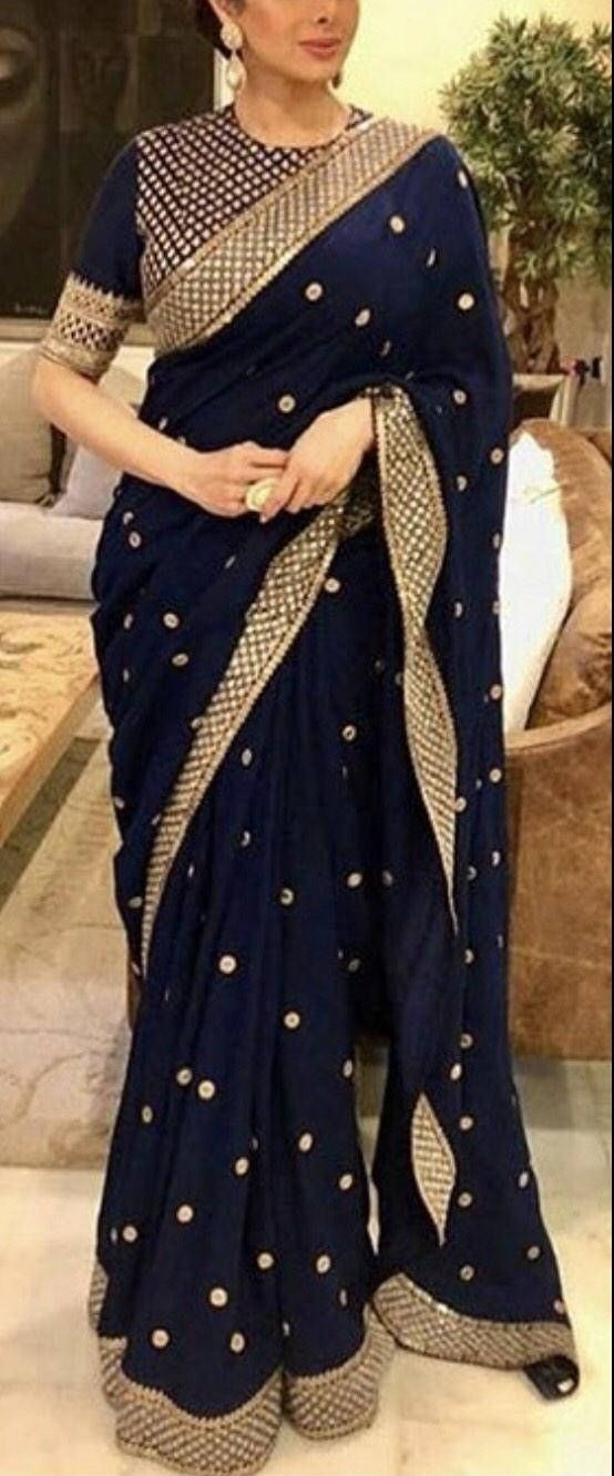 1311cc60fb Navy blue saree, Festive wear saree with gold borders and embroidered  blouse. This sari