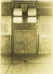 """In early December 1891, Canadian Dr. James Naismith ailed a peach basket onto a 10-foot (3.05 m) elevated track. In contrast with modern basketball nets, this peach basket retained its bottom, and balls had to be retrieved manually after each """"basket"""" or point scored"""