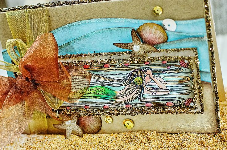 Beautiful Mermaid Card with Tutorial by Michele Kovack using Crafty Secrets Digital Mermaid Stamp Set and colored with Spectrum Noir Markers, Glossy Accents to add the Glitter, sequins, stamped seashells, how to create the wave layers and links to other DT Projects