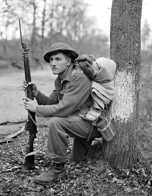 A Canadian soldier during the battle of Arnhem September 1944. Lee Enfield Rifle No. 4 Mk 1. .303 cal