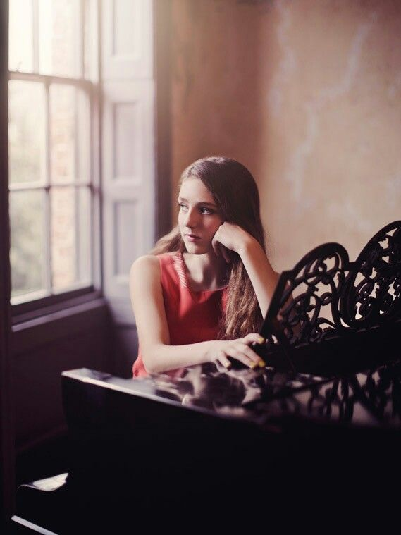 Evelyn|| I wander around the castle, there was so much I haven't explored yet. I crack the door open to a room and see a piano. I pull out the bench and take a seat. I place my fingers gently on the keys and start to play.