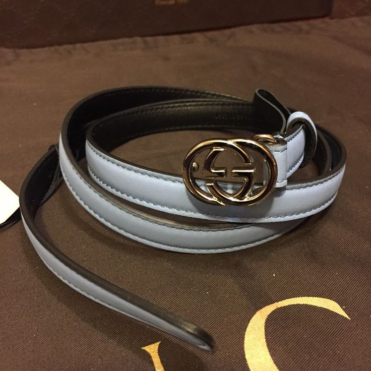"""New Gucci Women's belt. Light Blue Leather outside, black inside. Silver tone Gucci """"GG"""" logo for the buckle. Belt is approx 40 inches long (from buckle to last hole) not sure what size that equals, but measure a string around your waist to see if that will fit you. IF THE BELT IS TOO BIG A SHOE SHOP/COBBLER/ALTERATION STORE WILL USUALLY ADJUST THE LEATHER TO FIT YOU FOR A VERY INEXPENSIVE PRICE. (I paid $10 to p..."""