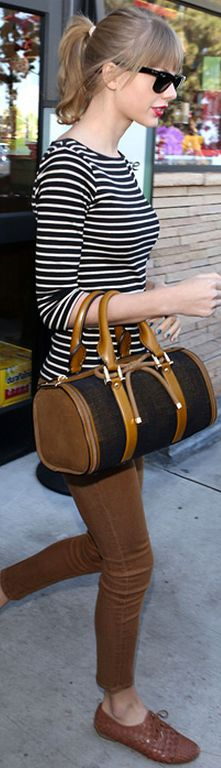 Taylor Swift. Sunglasses: Ray Ban, Jeans: Siwy, Purse: Burberry