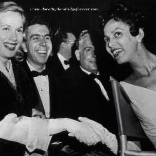Oscar night March 30, 1955:  Eva Maria Saint, who was nominated for best supporting actress for her role in On the Waterfront, is greeted by Dorothy Dandridge, best actress nominee for her role in Carmen Jones. Also pictured is Jeff Hayden, husband of Eva Marie Saint.
