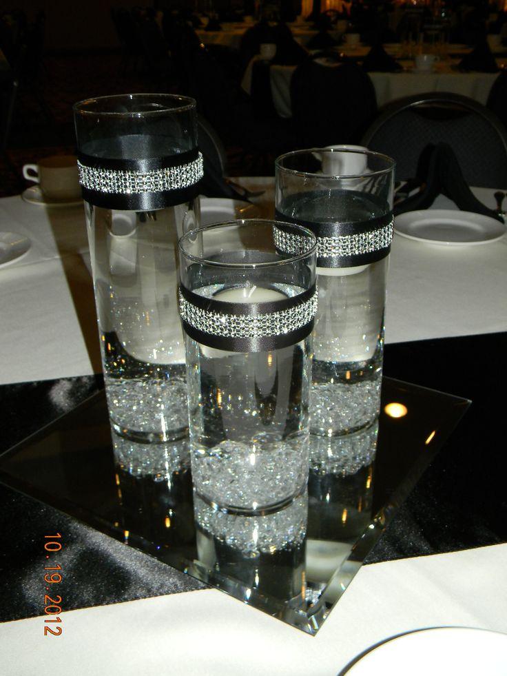 Black table runner, square mirror, set of 3 cylinders/diamond gems/black & rhinestone ribbon around cylinders, float candles