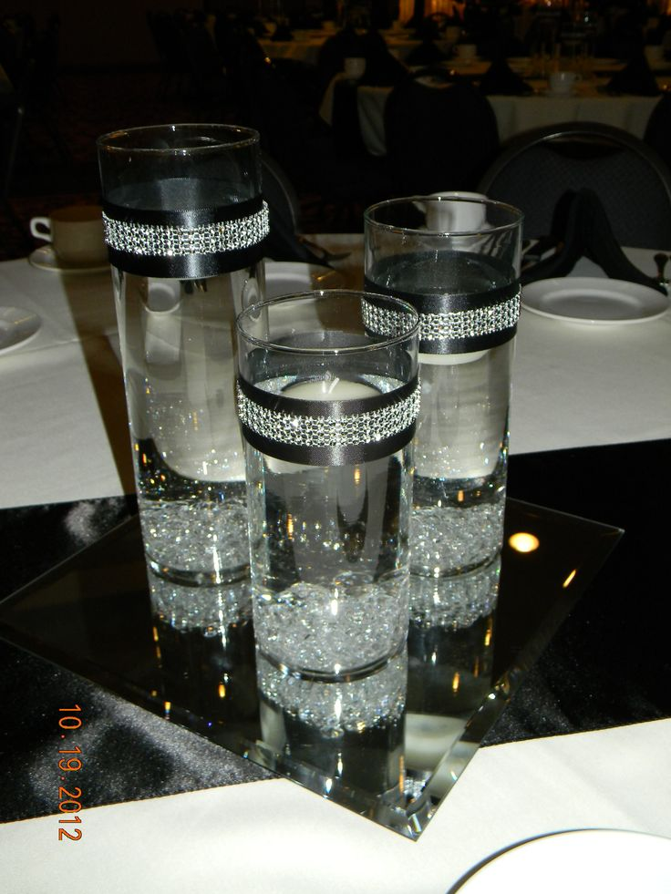 Black table runner, square mirror, set of 3 cylinders/diamond gems/black & rhinestone ribbon around cylinders, float candles