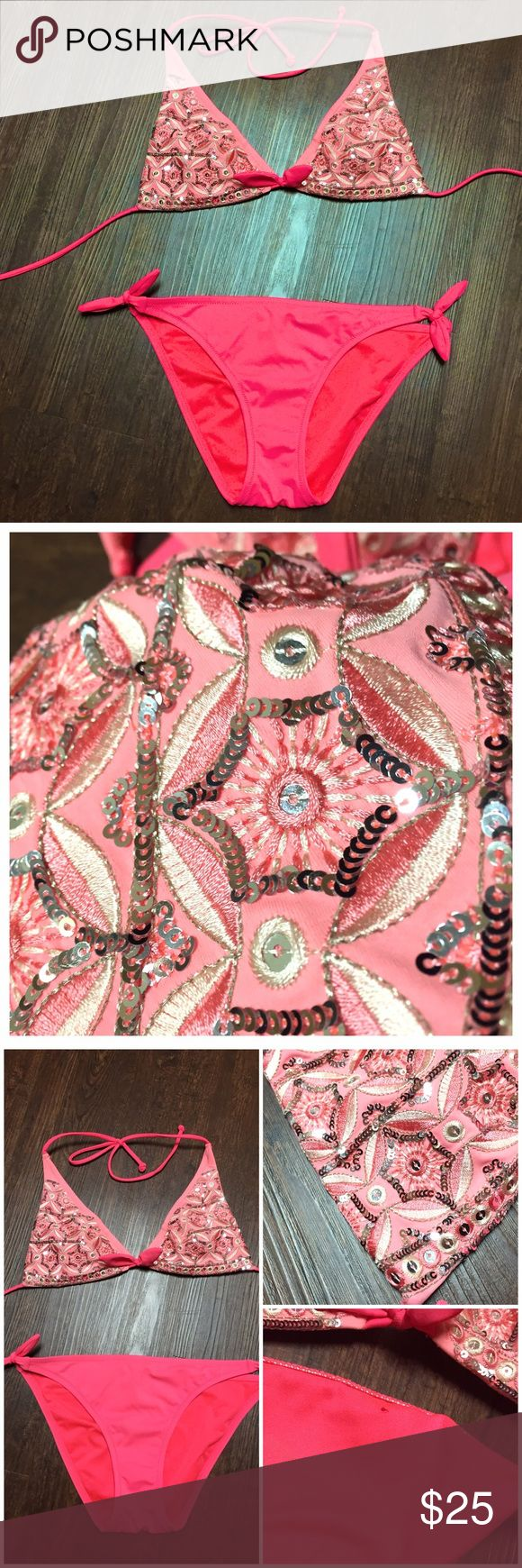 Pink Embroidered Sequin Bikini Beautiful Victoria's Secret swimsuit. Top & bottoms are size M but adjustable. I'm a small and it fits. The top is best for a full B/ C cup. I cut the tags out from both.  From the Beach Sexy collection. The top is embroidered and embellished with silver sequins. In good condition with a few missing sequins barely noticeable. Inside cups were lost and not included. The bottoms are in great condition; only defect being a tiny hole on the inner lining shown in…
