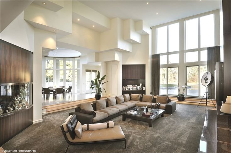 Modern Long Sectional With Sleeper Bench Beside In The Large Lounge Room