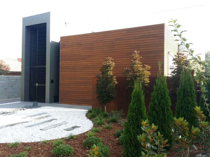 CUTEK Extreme, Sela Brown used for 200 m2 of Silver Top Ash hardwood cladding on this Architecturally designed home in Canberra Australia.