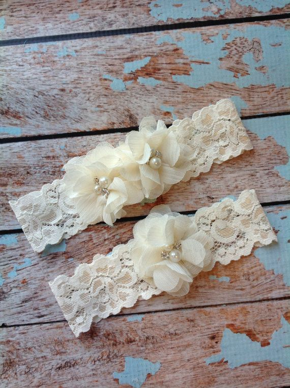 ***Includes toss and keepsake ****    2 ivory chiffon flowers with pearl and rhinestone accents make this keepsake garter so elegant - toss